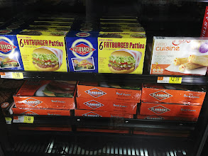 """Photo: On our way out of the aisle we looked down and saw this display. It was interesting because the Lean Cuisine was right next to the other """"less-healthy"""" choices. It definitely looked like a better health decision when it was sitting next to burgers."""