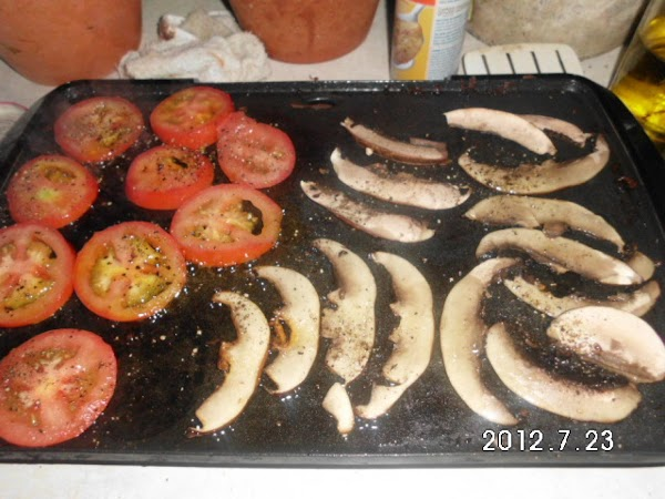 Meanwhile cook tomatoes and mushroom slices, and onion till tender, about 10 min.