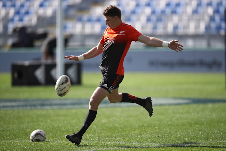 Beauden Barrett of the All Blacks kicks ahead during a New Zealand All Blacks Captain's Run at QBE Stadium on September 15, 2017 in Auckland, New Zealand.