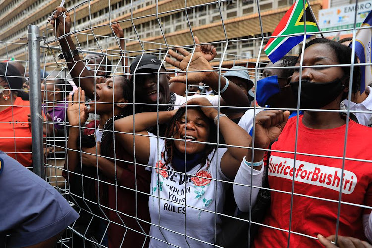 Jubilant Enlightened Christian Gathering church members in celebratory spirits as they welcome the Pretoria magistrate's court decision to grant their pastor Shepherd Bushiri bail on Wednesday.