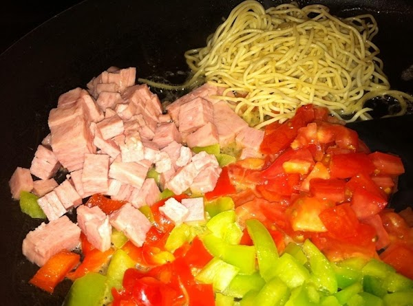 Prepare all of the veggies, put into buttered skillet.  Add spaghetti noodles to...