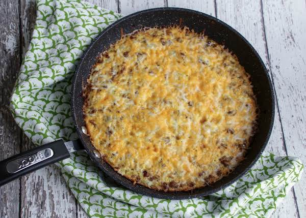 Baked Frittata With Cheese Sprinkled On Top.