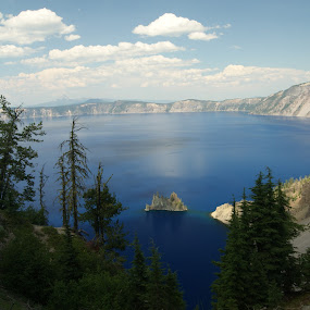 Phantom Ship, Crater Lake National Park by Beth Collins - Landscapes Waterscapes ( clouds, water, evergreens, oregon, crater lake, national parks, caldera, rock, lake, crater, national park, blue, trees, rock formation,  )