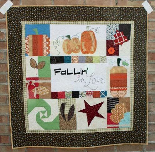 Quilt with Fall-Themed Designs