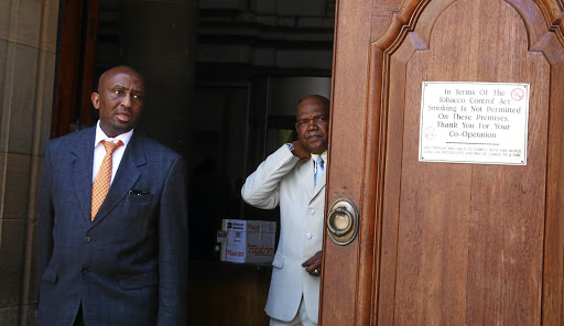 Richard Mdluli, right, and his lawyer Ike Motloung, leaving the South Gauteng High Court in Johannesburg after his appearance yesterday.