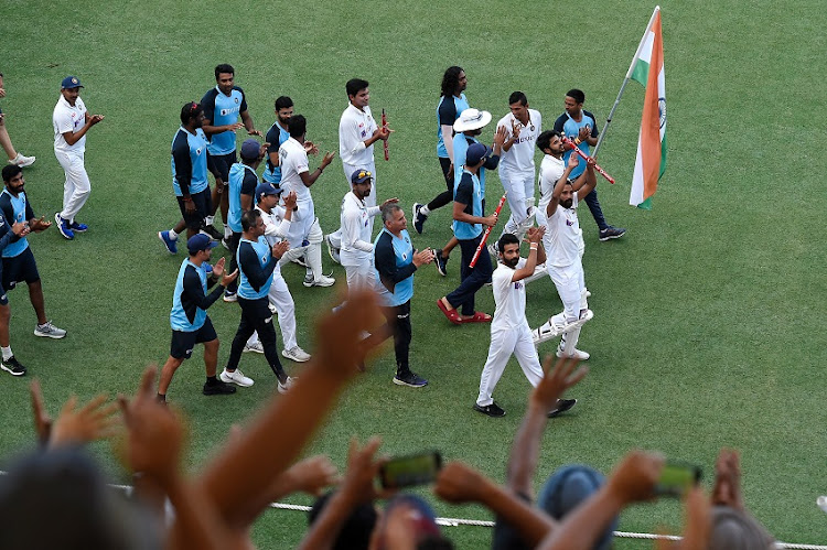 Players of India celebrate victory during day five of the 4th Test Match in the series between Australia and India at The Gabba on January 19, 2021 in Brisbane, Australia.
