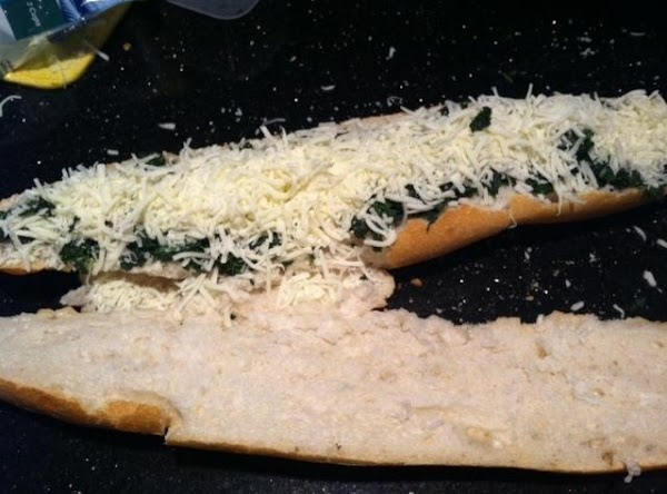 SPOON SPINACH ONTO SLIGHTLY HOLLOWED TOP OF ITALIAN BREAD SMOOTH TO COVER, THEN TOP...