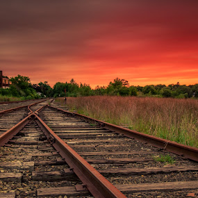 Split Tracks by Michael Otero - Landscapes Sunsets & Sunrises ( 17mm, train tracks, red sky, sigma glass, sigma, sunset, vibrant colors, dark clouds, vibrant, nd filter )