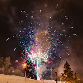 New Year's Fireworks At Cranmore Mountain II  by Chris Cavallo - Public Holidays New Year's Eve ( ski, mountain, snow, tree, winter, long exposure, glow, lights, night photography )