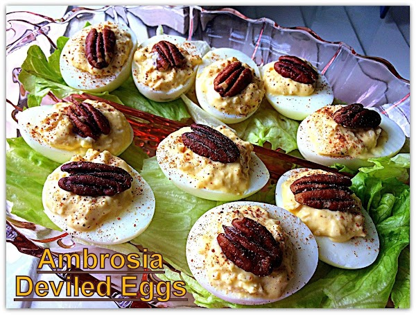 Fill the whites evenly with the mixture and garnish each egg half with a...