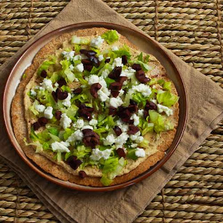 Mediterranean Tostada with Hummus, Feta, and Kalamata Olives