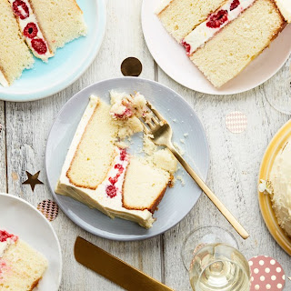 Double-Layer Vanilla-Buttermilk Cake With Raspberries and Orange Cream-Cheese Frosting