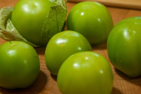 Remove the husks from the tomatillos, and thoroughly rinse.