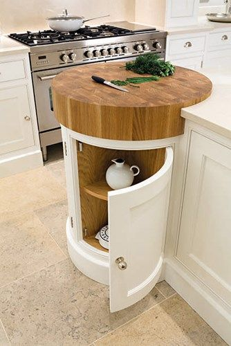 custom corner kitchen cabinet with rounded cabinet doors and butcher block countertop