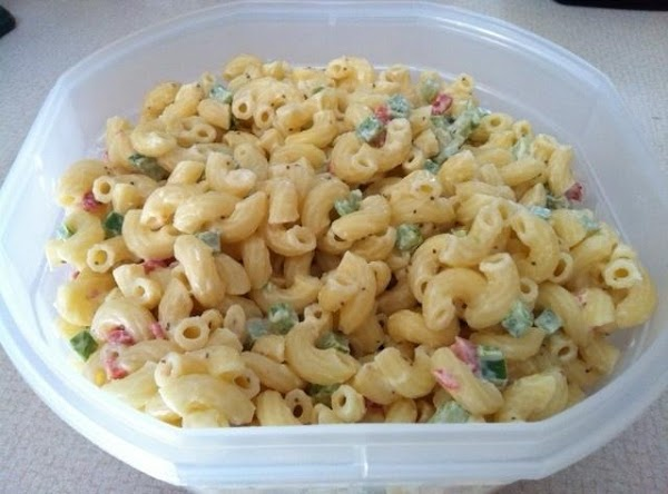 Combine with macaroni, celery seed, tomato, celery, and green pepper, if using.