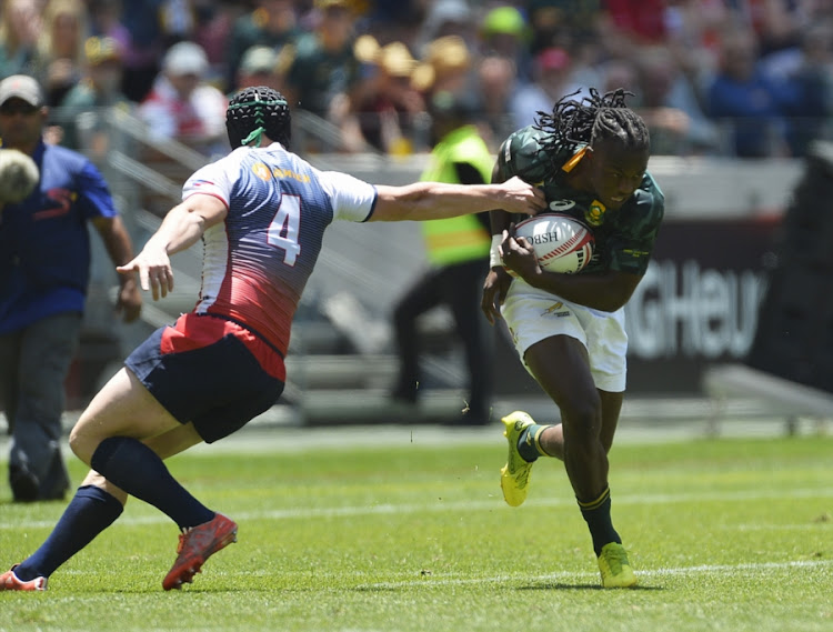 Seabelo Senatla of South Africa tackled by Sergei Ianiushkin of Russia during day 1 of the 2017 HSBC Cape Town Sevens match between South Africa and Russia at Cape Town Stadium on December 09, 2017 in Cape Town, South Africa.