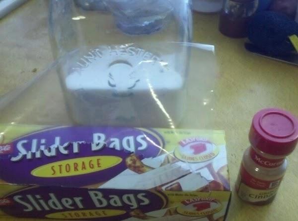 In large -storage plastic food bag, mix granulated sugar and cinnamon.