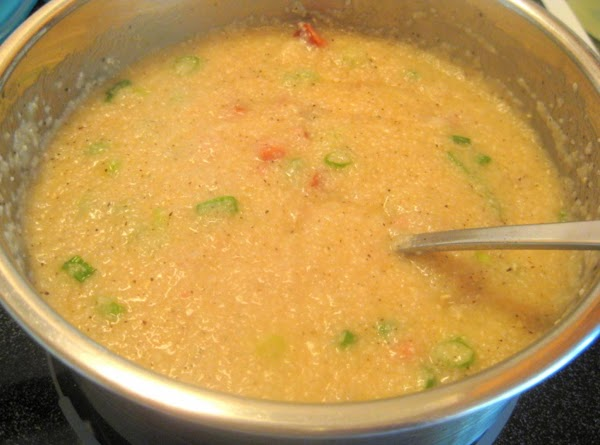 When cooked remove from heat and stir in sausage, cheese, green onions, garlic powder...