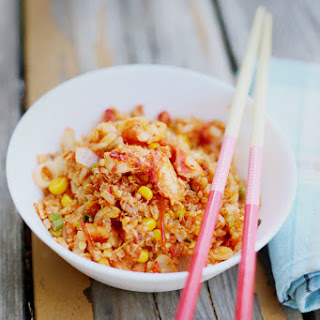 SPICY STIR-FRIED QUINOA WITH LOBSTER TAILS.
