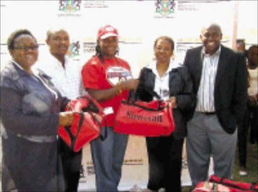 GIVING HAND: Patliso Magape-Mokoto, left, manager of the Boikagong Children's Home, Herman Ramokala, service point manager of Ditsobotla, Lindi Obose, Mpumelelo Nhlapo of the the provincial social development department and Nomvuka Nomnga, director of Ngaka Modiri Molema district municipality. Pic. John Matona. 01/09/08. © Unknown.