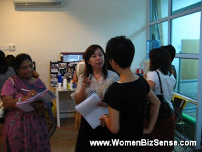 Photo: Mety, WBS Treasurer (middle), speaks to 2 attendees.