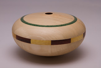 "Photo: Donald Van Ryk 5"" x 3"" segmented hollow form [holly, cocobolo, yellowheart, and corian]"