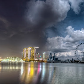 day and night split shot of Singapore Skyline by Paul Cowell - Buildings & Architecture Office Buildings & Hotels ( flyer, clouds, night light, skyline, marina bay sands, postcard, cityscape, day/night, attraction, singapore, panorama, split shot, gardens by the bay, casino, hotel )