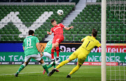 Bayer Leverkusen striker Kai Havertz heads in their first goal, as play resumes behind closed doors following the outbreak of the coronavirus disease (Covid-19). The match took place at the Weser-Stadion in Bremen, Germany, on May 18 2020.
