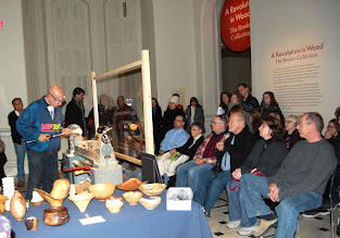 Photo: Mike turns some nice shavings to a standing-room-only crowd!