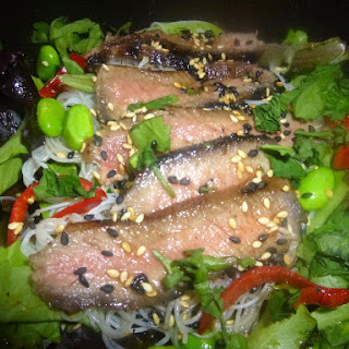 Marinated Steak on a Soya Bean and Rice Noodle Salad with Mirin and Pomegranate Dressing