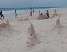 Photo: Sand Castle artists on the Harbor Island beach