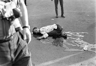 Photo: Một cuộc pháo kích tấn công bất ngờ bởi bọn khủng bố Việt Cộng ẩn qua sông Sài Gòn đã giết bảy người Việt Nam và một người Mỹ, và làm bị thương 30 người khác, khi đạn pháo không giật 75mm rơi vào đám đông tập trung trong lễ kỷ niệm ngày Quốc Khánh 01 tháng 11 tại trung tâm thành phố Sài Gòn. Một số đạn pháo khác bắn vào Bệnh viện Grall, một nhà thờ Công giáo và trường học và trên đường phố, và cả Chợ Bến Thành - Sài Gòn. http://www.vietnam.ttu.edu/virtualarchive/items.php?item=VA004352 A sudden attack by Viet Cong terrorists hidden across the Saigon River killed seven Vietnamese and one American, and injured 30 other persons, when 75mm recoilless rifle shell fell on crowds gathered for national Day celebrations on November 1 in downtown Saigon.; Some of the shells fell on the Grall Hospital, a Catholic church and school and on streets, including the busy Saigon Market.