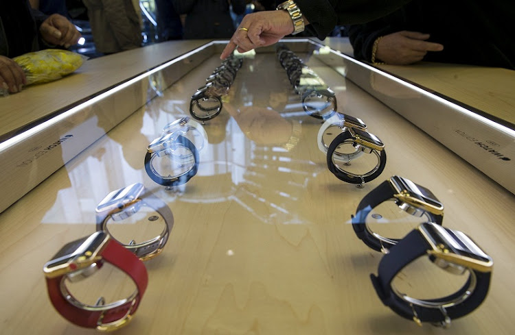 Customers look at the new Apple Watch displayed at an Apple Store in New York. Picture: REUTERS