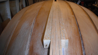 Photo: I laid out the taper to the keel rub strakes with a long cedar batten.