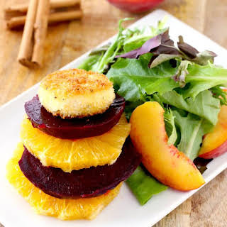 Crispy Goat Cheese Coins with Salad of Roasted Beets, Peaches, Oranges and Mixed Greens with Orange Honey Vinaigrette.