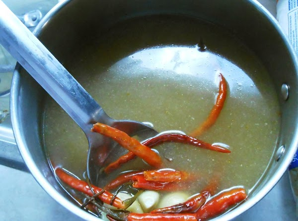 Simmer broth with 4 cloves of garlic and 12 chile de arbol dried peppers...