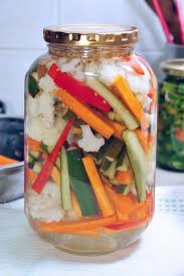 Cut veggies in strips or slices or for small  veggies leave whole. Add...