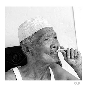 older smoker by Vandy Ahmad - People Portraits of Men