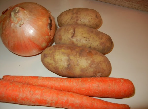 Place cubed potatoes, carrots, and onion into beef mixture.  Pepper to taste and...