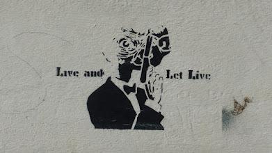"""Photo: Stencil; Unknown Artist; """"Live and let live""""; """"ET-Bond"""""""