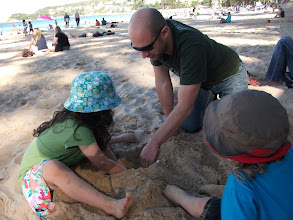 Photo: Digging at Manly beach