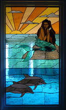 Photo: Bright colorful stained glass mermaid and dolphin window, custom handmade and beautiful leaded glass. Replaced clear glass with stained glass thermopile unit. Allows for beauty and privacy. Fantasy, fiction, mystical, fantastical, ocean.