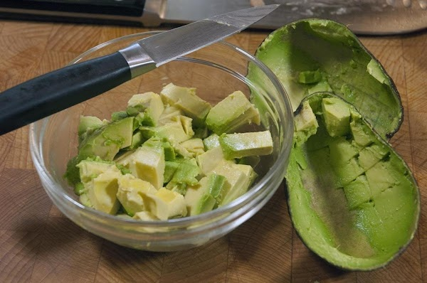Add the avocado to a bowl and reserve.