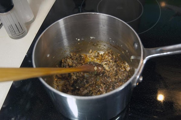 Add the dry spices (chili powder, paprika, parsley, cayenne, and oregano), and cook until...