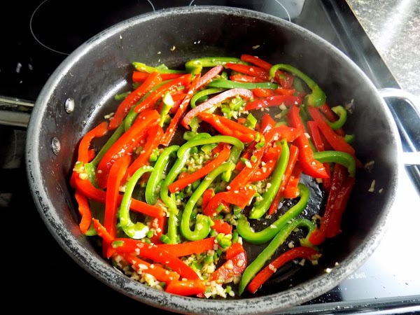 Slice peppers into long thin strips and saute with chopped jalapeno (I left a...