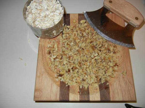 Add nuts and oatmeal to batter and mix.