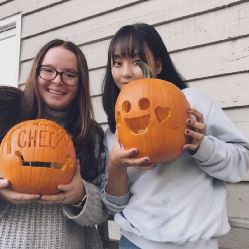 Korean Buddy participants holding carved pumpkins or jack-o-lanters