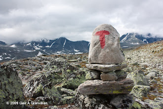 Photo: T-marked hiking trail on the Southern side of Snøhetta. The Norwegian Tourist Association (Den Norske Turistforening - DNT) maintains and extensive network of T-marked hiking trails in the Norwegian mountain areas.