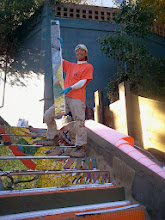 Photo: Fifth full day of work (October 31, 2013): KZ Tile worker (Sing) on fourth flight of steps from bottom of the Hidden Garden Steps (16th Avenue, between Kirkham and Lawton streets in San Francisco's Inner Sunset District), holding piece of the 148-step ceramic-tile mosaic designed and created by project artists Aileen Barr and Colette Crutcher. More than 80 pieces were in place by the end of the day. For more information about this volunteer-driven community-based project supported by the San Francisco Parks Alliance, the San Francisco Department of Public Works Street Parks Program, and hundreds of individual donors, please visit our website at http://hiddengardensteps.org.