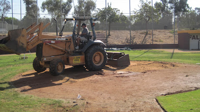 Photo: Adding material to homeplate areas to raise up to meet new grade.